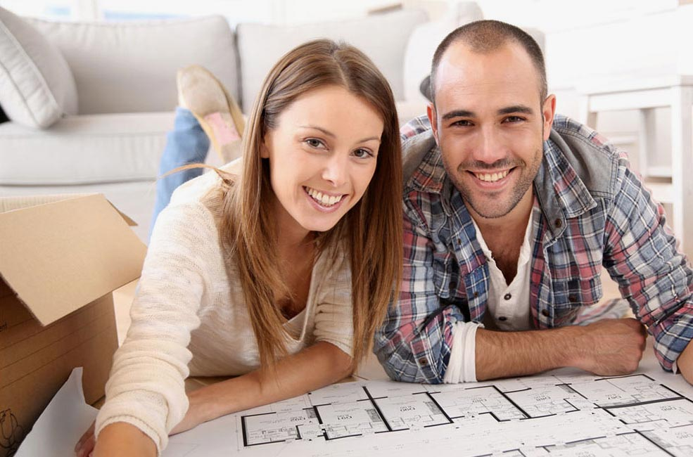 Happy couple looking at building plans